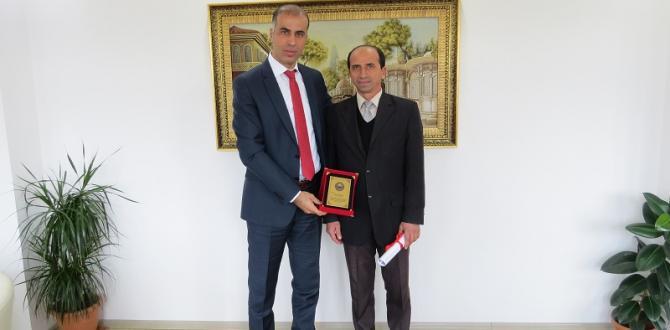 KAYMAKAM'DAN KARATAŞ'A PLAKET